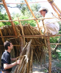 Dr. Dib and Evangelista Mojica (right) work to construct housing structures to prevent and control Chagas disease. Image courtesy of Tropical Health Foundation